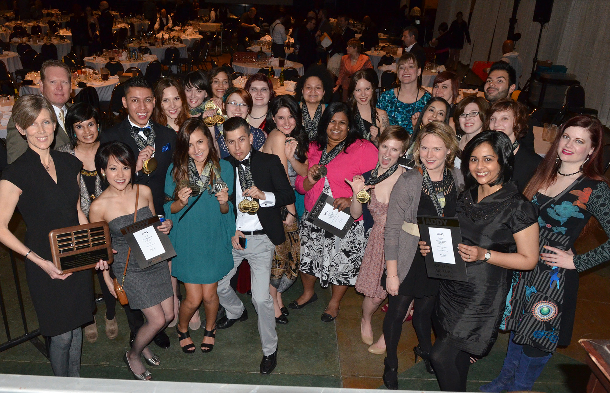 University of Central Oklahoma design students, alongside design faculty, show off the 90 awards they earned at the 2014 Oklahoma City Ad Club's ADDY Awards.