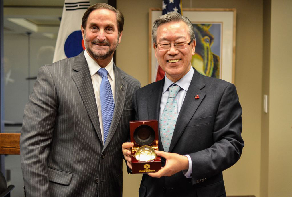 University of Central Oklahoma President Don Betz (left) and Busan National University of Education in South Korea President Kim Sang-Yong (right) met to sign an agreement to become partner universities.