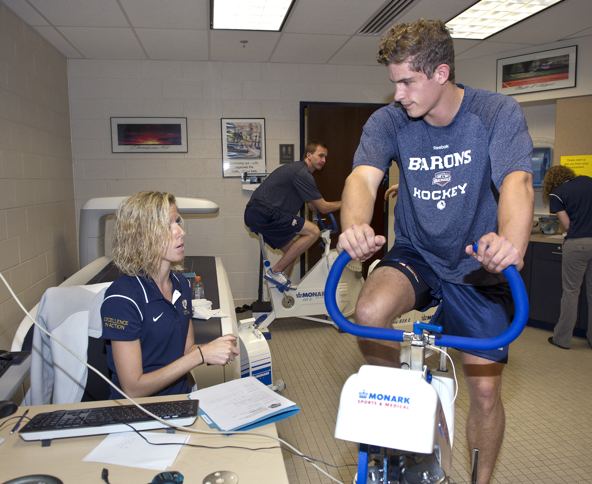 Kristin Bogda, a student in the University of Central Oklahoma Department of Kinesiology and Health Studies, administers a health screening for a Oklahoma City Barons hockey player.