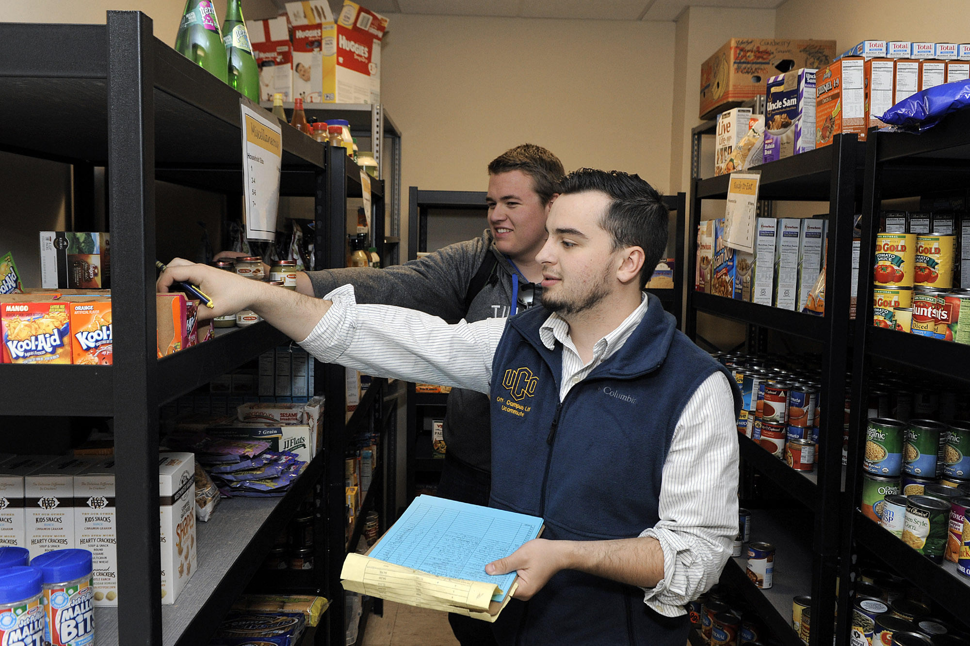 University of Central Oklahoma students Joel Richardson and Seth Williams volunteer at the Central Pantry. The pantry recently marked a year of service to campus.