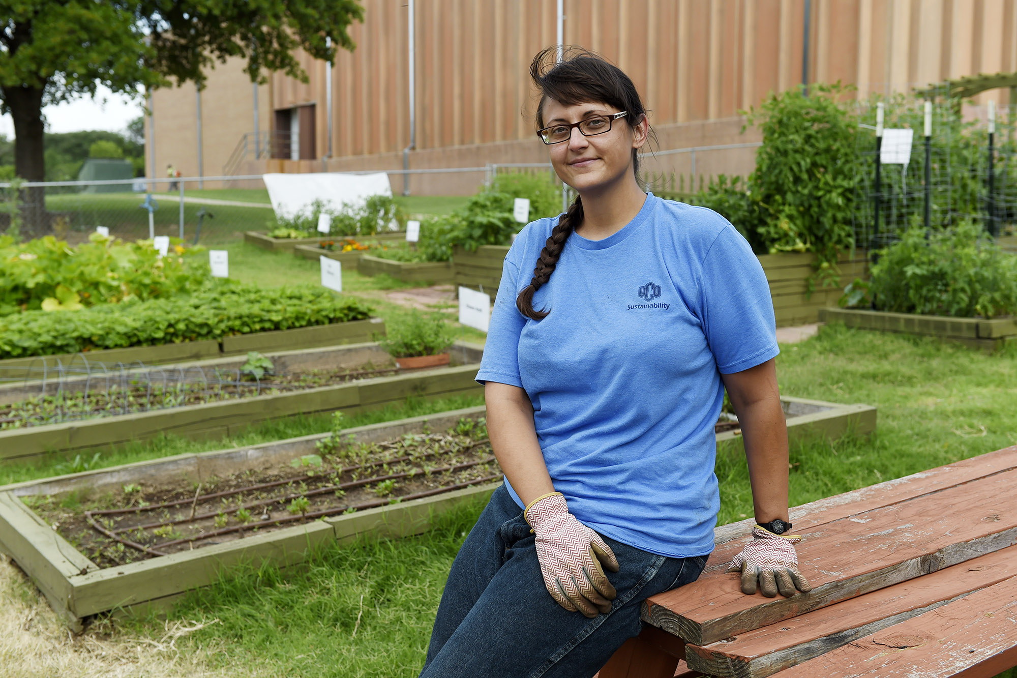 Jennifer Swann, UCO graduate student and summer intern for the university's Volunteer and Service Learning Center, oversees the center's community garden.