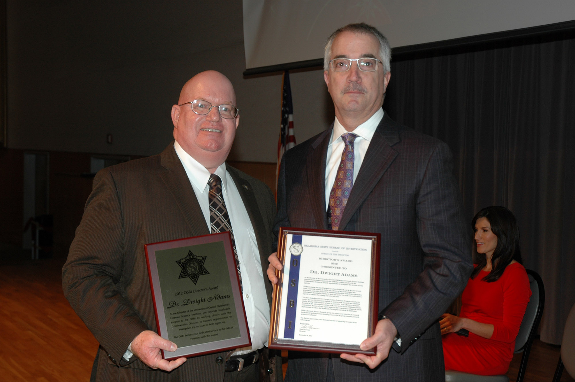 The Oklahoma State Bureau of Investigation (OSBI) Director Stan Florence (left) awarded Dwight Adams, Ph.D., (right) director of the University of Central Oklahoma W. Roger Webb Forensic Science Institute, the Director's Award for Law Enforcement at the annual OSBI Awards Banquet at the National Cowboy and Western Heritage Museum on Dec. 4.