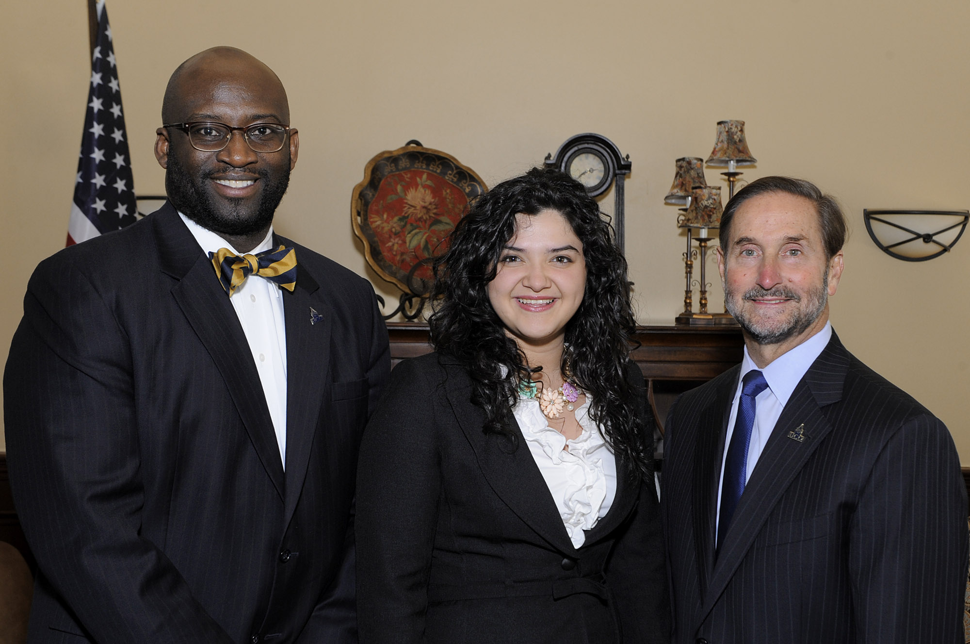 University of Central Oklahoma student and 2014 Newman Civic Fellow Elizabeth Larios stands with Central President Don Betz, Ph.D., (right) and Vice President for Student Affairs Myron Pope, Ed.D., (left). Larios was nominated for the award in recognition of her work in advocating for women's education and empowerment.