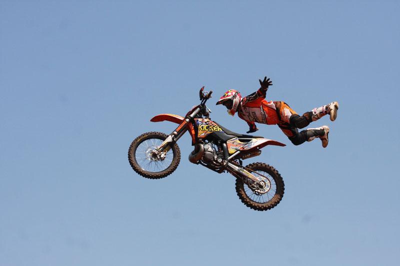 Motocross dirtbike in the air — Stock Photo © membio #5265517