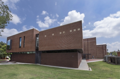 A portrait of a brick building, the Mitchell Education Center