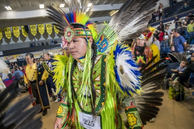 A traditionally-dressed Native American performer attends a UCO Spring Pow Wow.