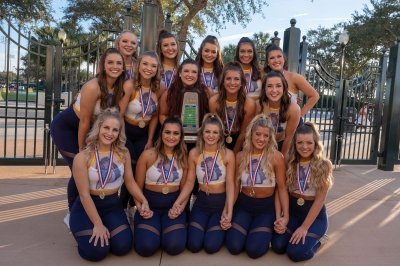 Members of the UCO pom team pose with their trophy